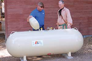 Employee Completing Value Added Services for Residential Propane Customers