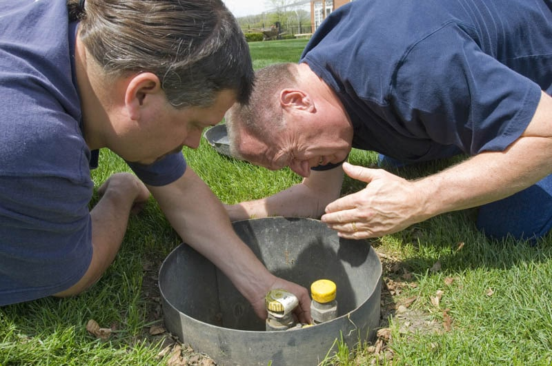 two men conducting sniff test to detect leak in propane system