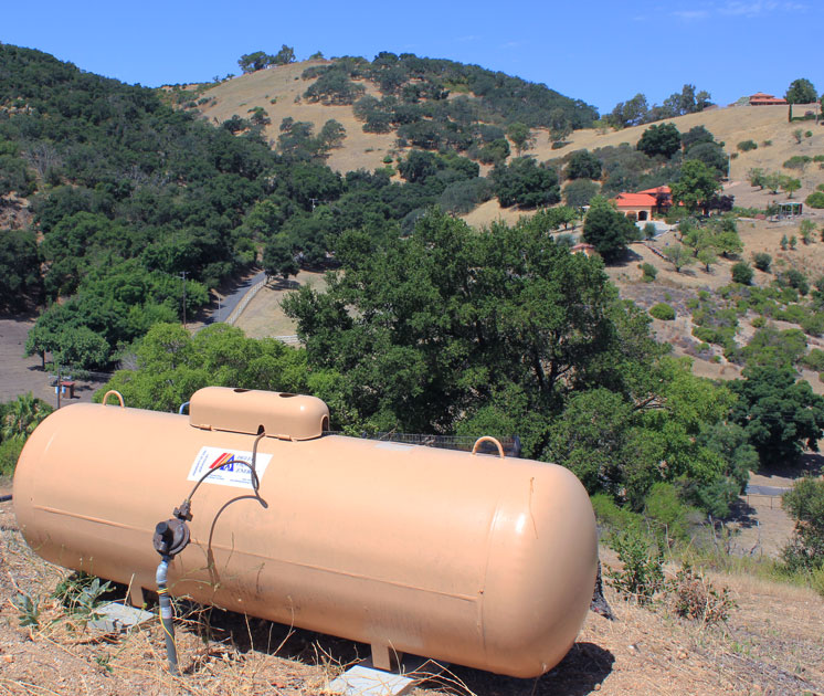 a propane tank on a hill
