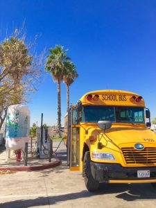 School bus filling up with propane using Arro Autogas fueling station